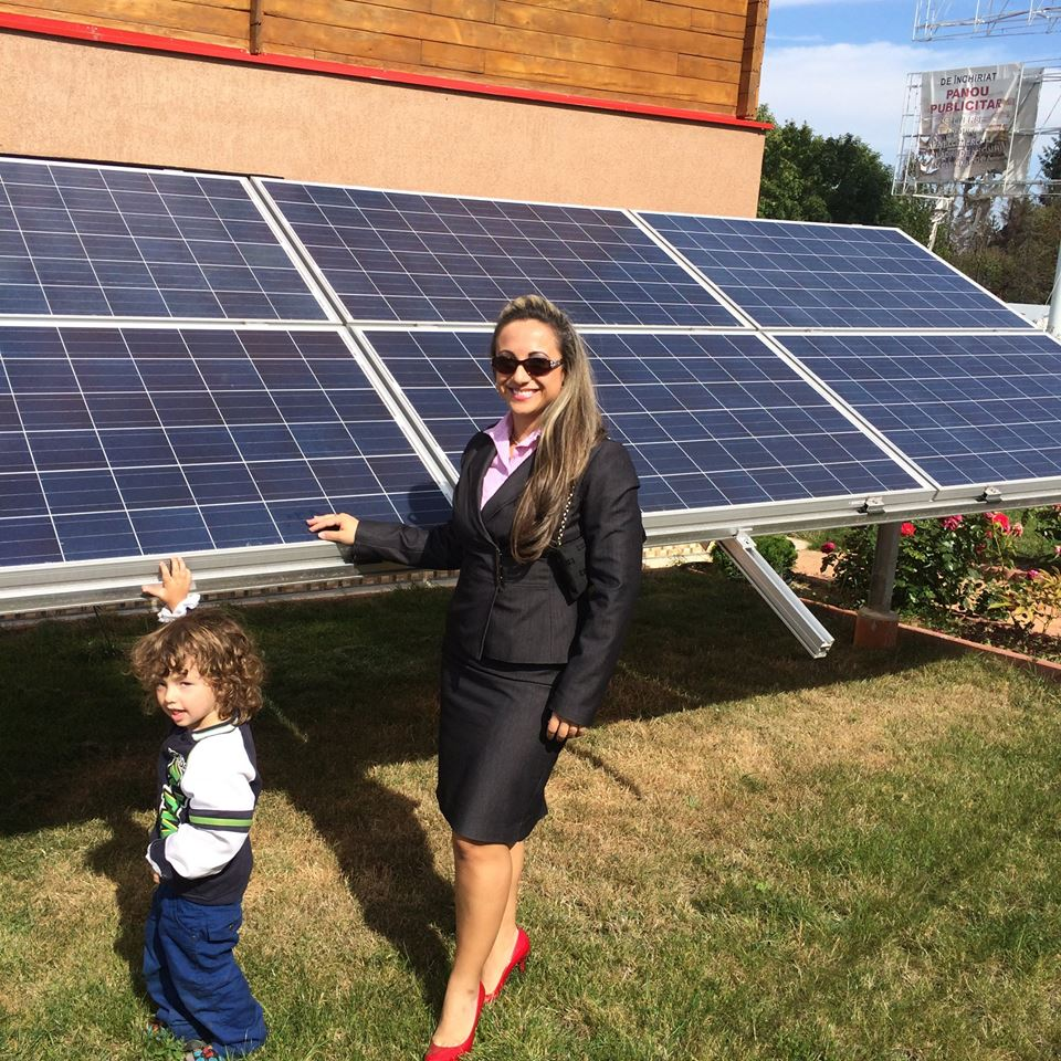 Kid displays solar as the way for the future along with Ms. Valdes